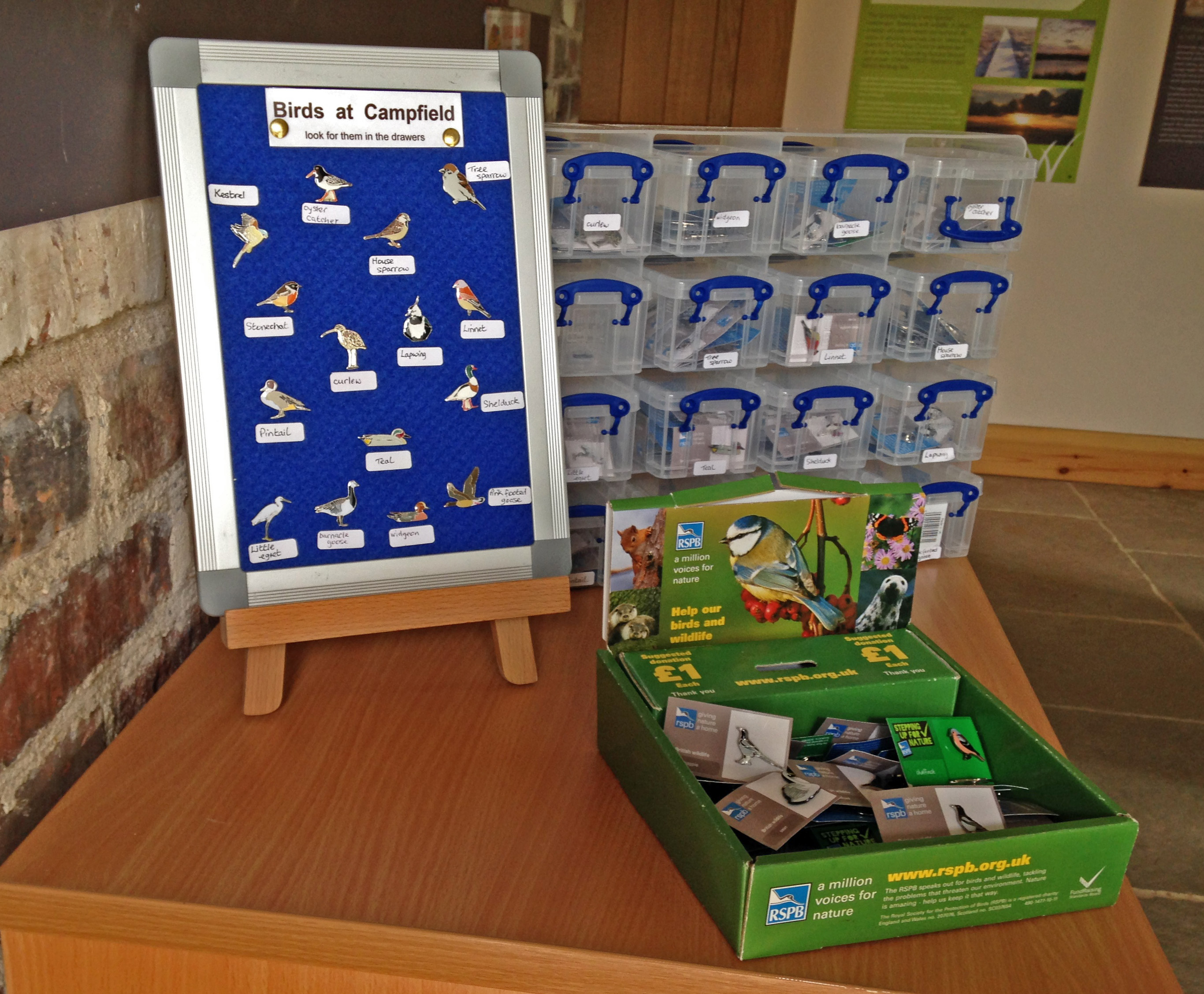RSPB Pin Badge display at the Solway Wetlands Centre, Campfield