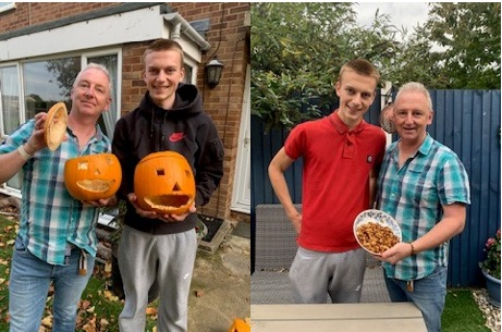 Chris and Miles with their carved pumpkins and roasted seeds
