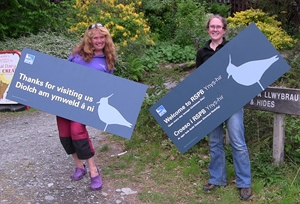 Our new signs being modelled by reserve staff