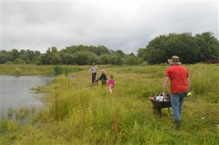 Family Volunteers managing the meadow (Joe Crossland)