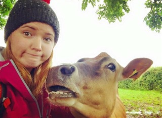 Holly getting up close to a cow