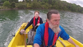 RSPB staff members in boat travelling to Blue Circle Island.