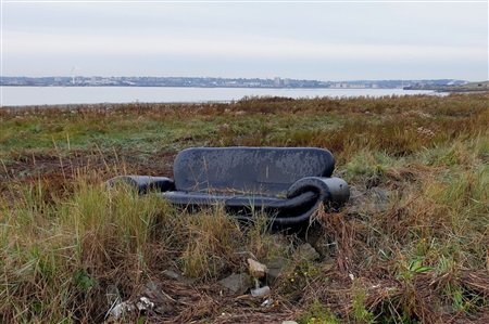 A sofa washed up at Rainham Marshes