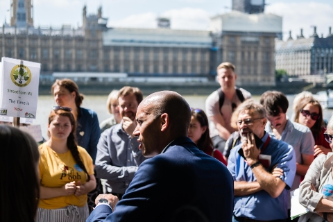 Chuka Umunna talks to his constituents, beside the Thames with Westminster in the background