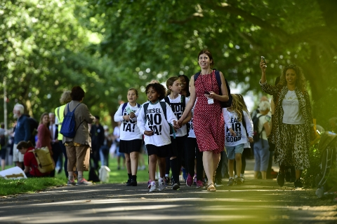 A teacher leads her group of schoolchildren to meet the MP for their school