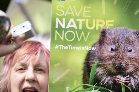 Lady with a Save Nature Now placard at The Time Is Now mass lobby