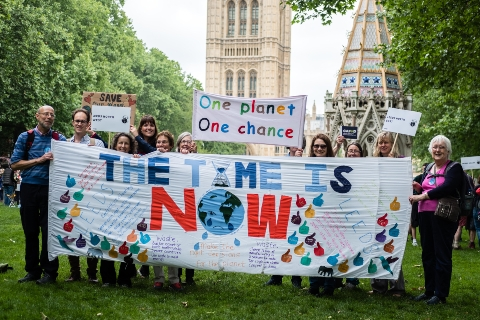 Constituents from Leeds North display a huge handmade banner saying The Time Is Now