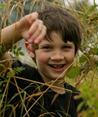 Boy having fun foraging by Andy Hay (rspb-images.com)