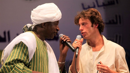 Sam Lee performing on stage with Omer Ihas