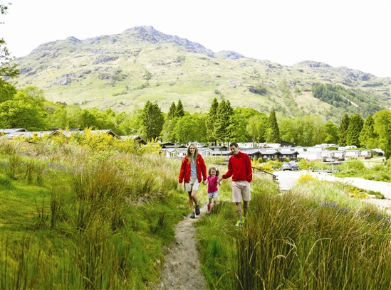 Family exploring lodge near Loch Lomond. Photo by Wyndham Holidays.