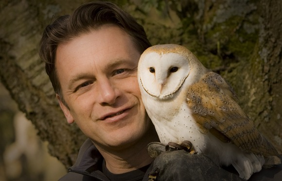 Chris Packham with a barn owl