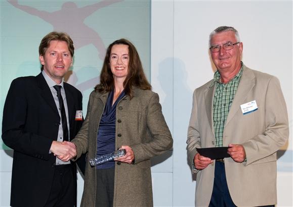 Shirley Boyle and volunteer Dick Rabjohn accepting the award